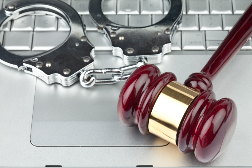 gavel and handcuffs on laptop